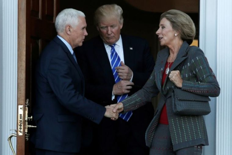 Donald Trump, Betsy DeVos, Mike Pence