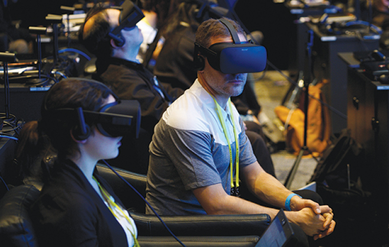 Showgoers wear Oculus Rift virtual reality headsets during the Intel press conference at CES in Las Vegas, January 4, 2017.