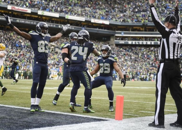 a0b4bbcd Seattle Seahawks running back Marshawn Lynch (24) celebrates with wide  receiver Ricardo Lockette (83) and wide receiver Doug Baldwin (89) after  scoring a ...