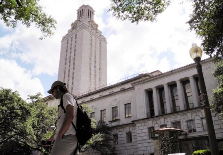A student walks at the University of Texas campus in Austin, Texas, U.S. in June 2016.