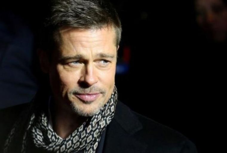 Brad Pitt arrives at the premiere of the movie