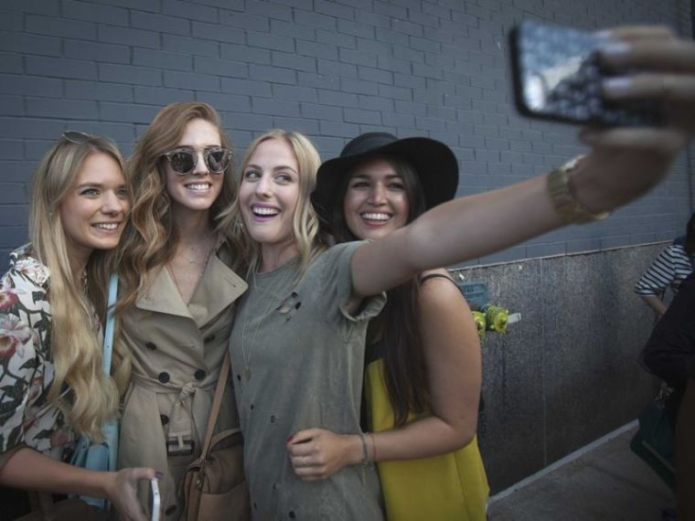 Millennials taking a selfie