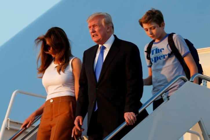 7b3d78f6d6 The image features U.S. President Donald Trump with his wife Melania and  son Barron.