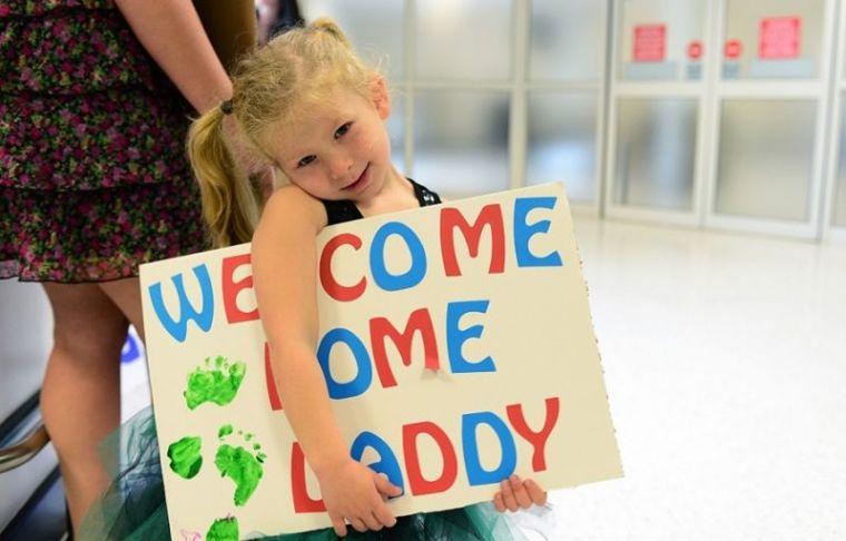 Daughter welcoming dad
