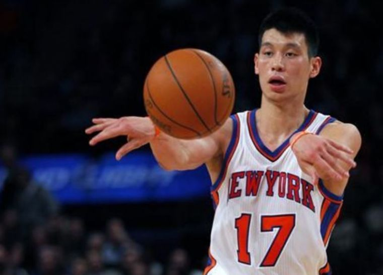 A photo of Jeremy Lin passing a ball during an NBA basketball game back in February 2012.