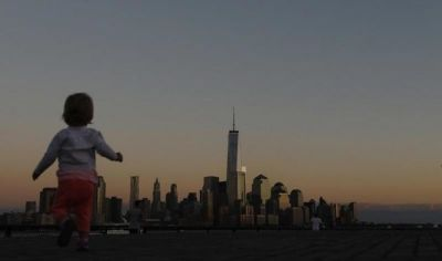Girl in front of New York skyline