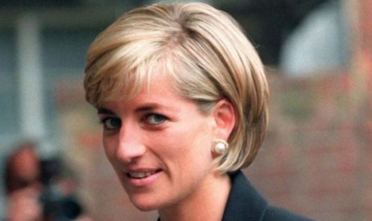 Princess Diana arrives at the Royal Geographical Society in London for a speech on the dangers of landmines throughout the world on June 12, 1997.