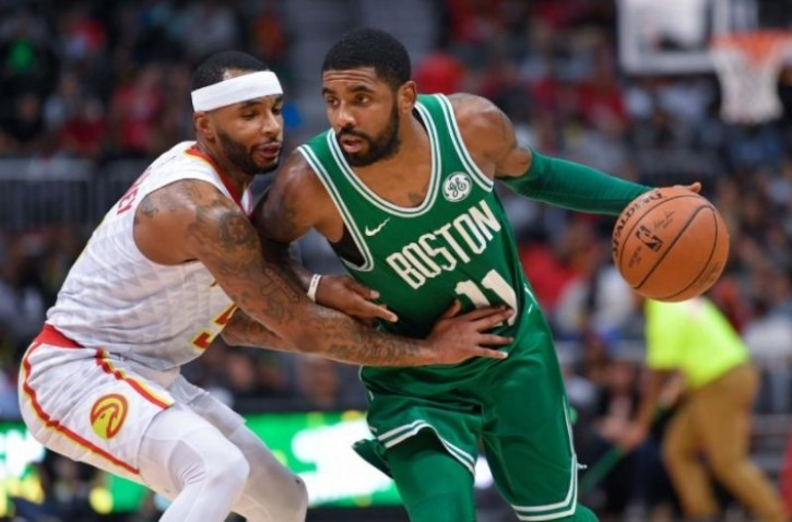 b2a2d8597e67 Boston Celtics guard Kyrie Irving (11) is guarded by Atlanta Hawks guard  Malcolm Delaney (5) during the second half at Philips Arena