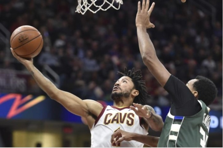 f55f0cb14253 Cleveland Cavaliers guard Derrick Rose (1) shoots the ball past Milwaukee  Bucks forward John Henson (31) in the second quarter at Quicken Loans  Arena