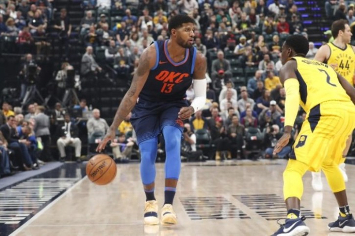 2e79b5431 Oklahoma City Thunder forward Paul George (13) dribbles the ball as Indiana  Pacers guard Darren Collison (2) defends during the first quarter at  Bankers ...