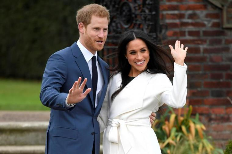 Prince Harry and Meghan Markle in front of the Kensington Palace. | REUTERS/Toby Melville
