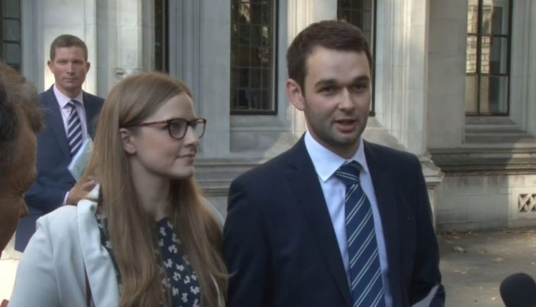 Daniel McArthur (R) and his wife Amy
