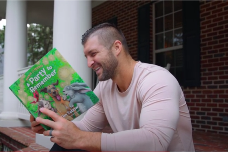 Tim Tebow with children's book