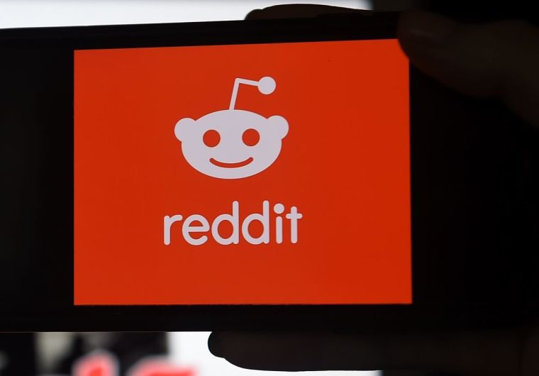 This photo illustration shows the logo of Reddit on a mobile phone in Arlington, Virginia on January 29, 2021 | AFP via Getty Images/ Oliver Douliery