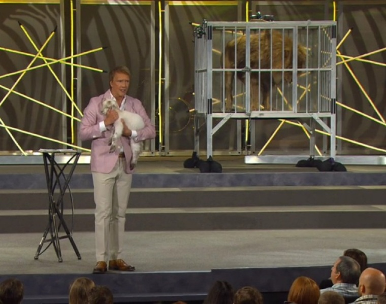 Pastor Ed Young with lion and lamb