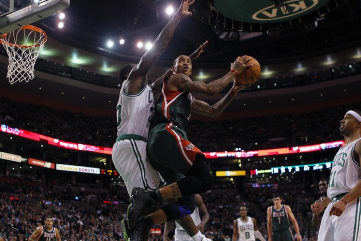 71c20f4fc620 Milwaukee Bucks Monta Ellis (center R) goes up for a shot against Boston  Celtics Brandon Bass in the second half of their NBA basketball game at TD  Garden ...