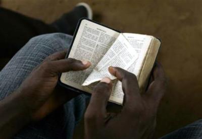 Boy reads bible