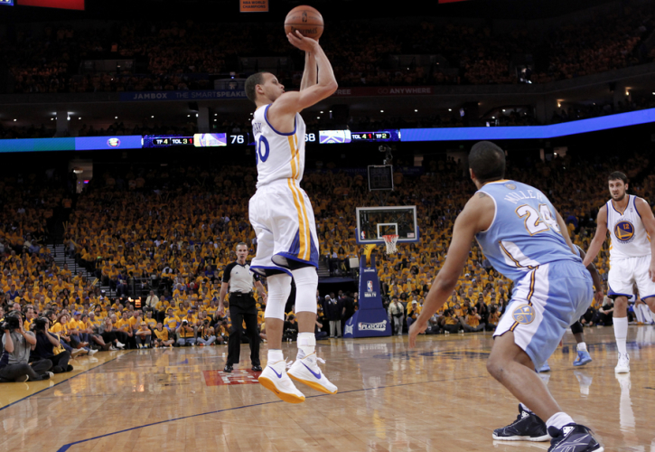 85d00a93e8e4 Golden State Warriors  Stephen Curry (L) shoots over Denver Nuggets  Andre  Miller (front on R) during Game 4 of their NBA Western Division  quarter-final ...