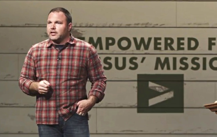 Mark Driscoll preaches at one of Mars Hill Church's campus. In 2012, approximately 14,000 people attended services at Mars Hill Church locations weekly.