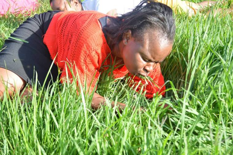 Woman eats grass, Rabboni Centre Ministries, South Africa