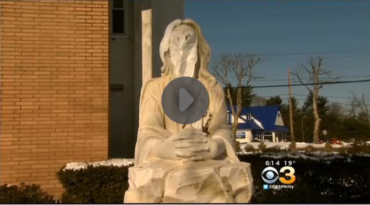 Defaced Statue of Jesus