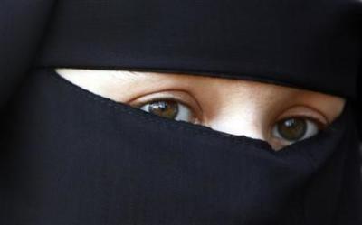 Muslim woman wearing burqa