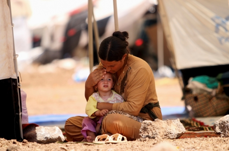 A refugee woman from the minority Yazidi sect