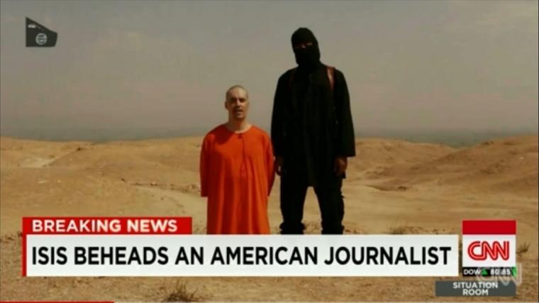 U.S. journalist James Foley (L)