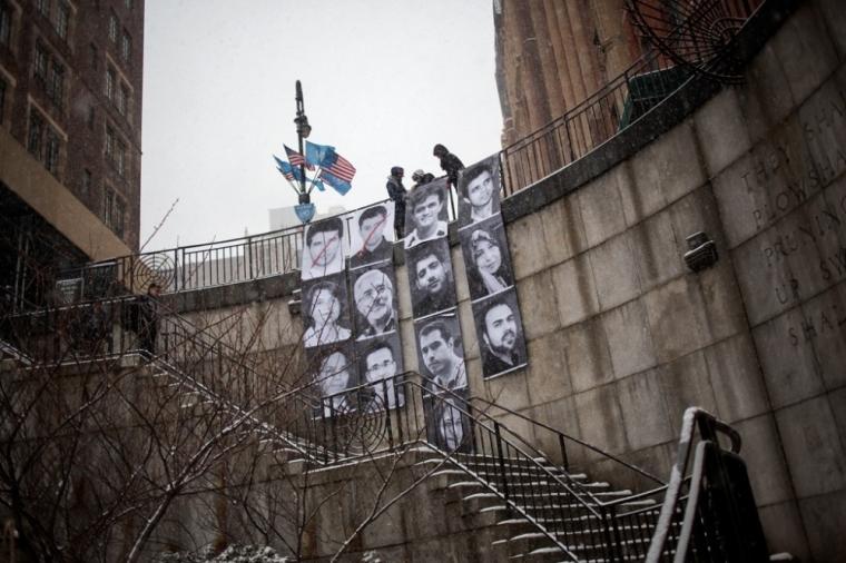 Portraits of 13 Iranian prisoners