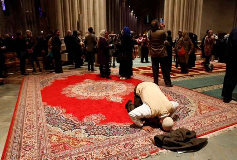Muslim groups hold prayer inside the Washington National Cathedral