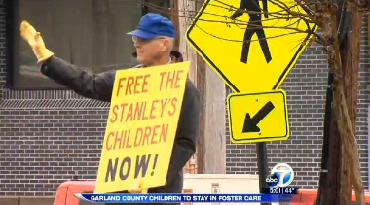 Stanley Family Protest Sign