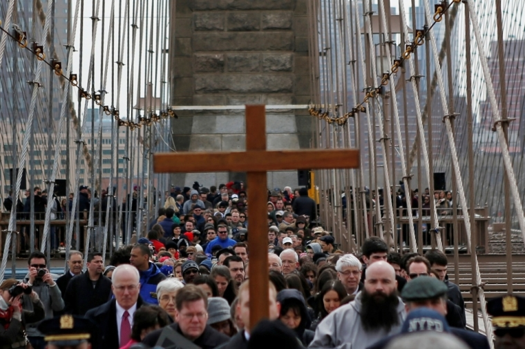 "Christians walking in the 19th annual ""Way of the Cross Over the Brooklyn Bridge Ceremony"""