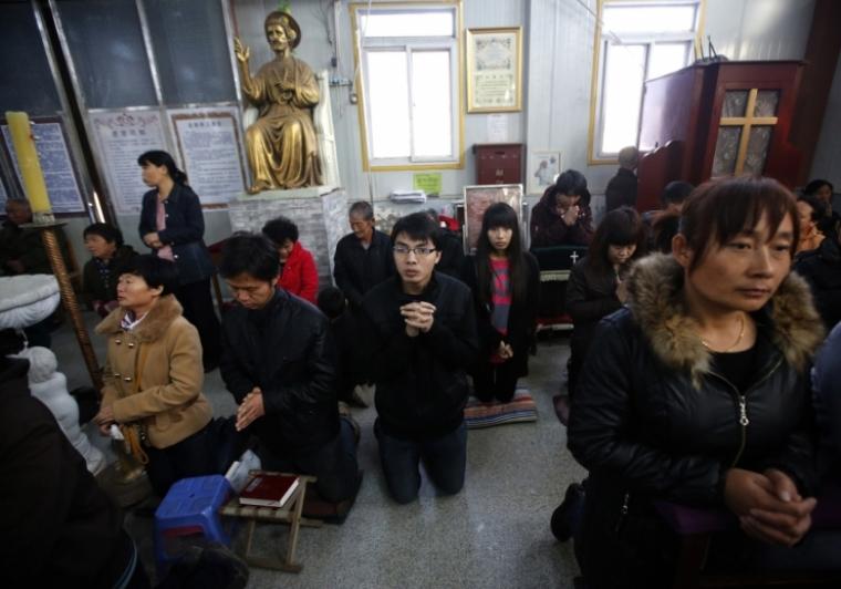 Chinese Christians Praying in Underground Church.
