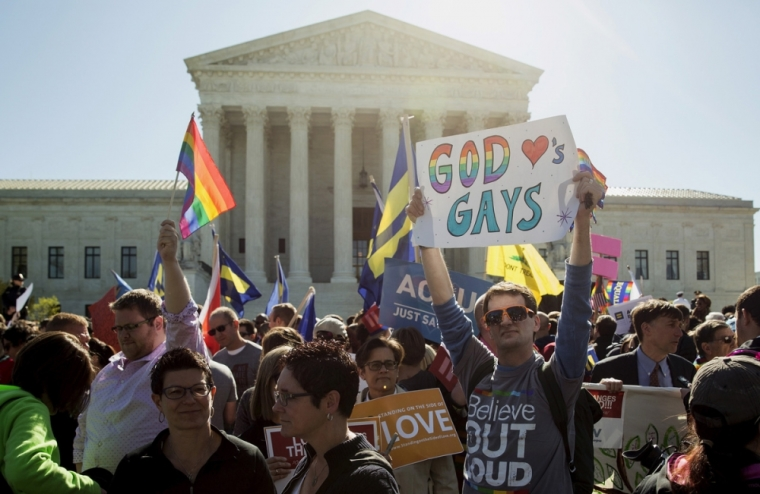 """Gay marriage supporter with """"god loves gays"""" sign"""