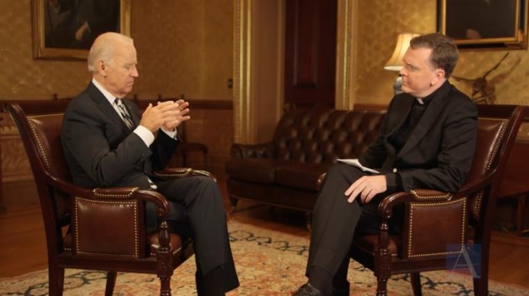 Joe Biden (L)