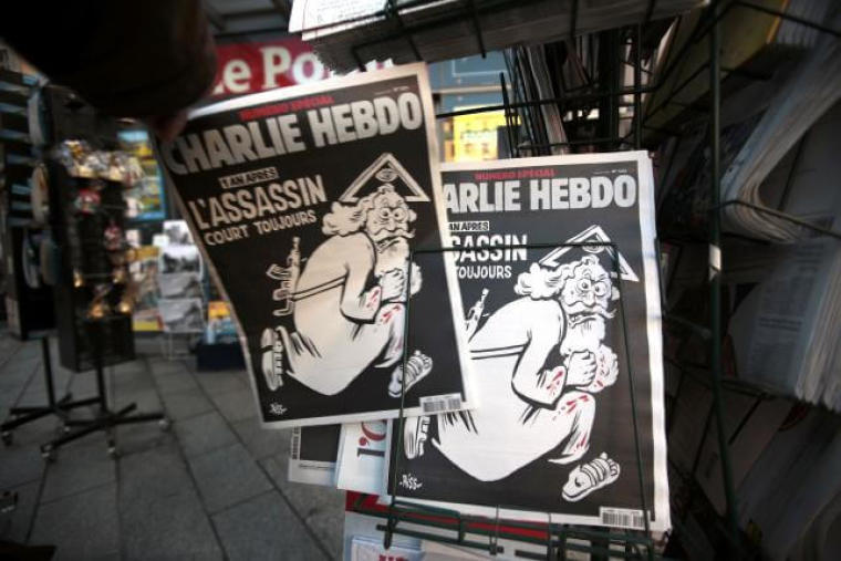 A man takes a copy of the latest edition of French weekly newspaper Charlie Hebdo with the title 'One year on, The assassin still on the run' displayed at a kiosk in Nice, France, January 6, 2016. | (Photo: Reuters/Eric Gaillard)