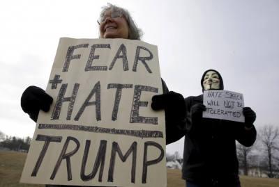 Demonstrators protest Donald Trump