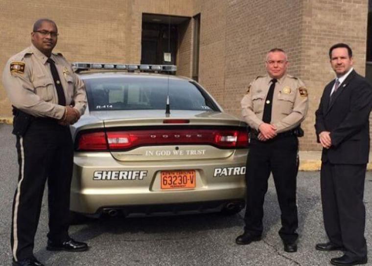 Lt. Leon Godlock, Lt Warren Sprouse, Sheriff Chris Francis.