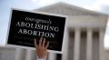 Idaho governor signs bill banning most abortions if Roe is overturned